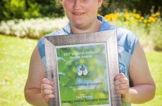 Tara Presley from Warragul District Specialist School accepting her certificate at the recent Award presentation ceremony.