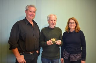 Jim Fogarty (left) and AB Bishop (right) present Leigh Siebler with the HMA V President's Award.